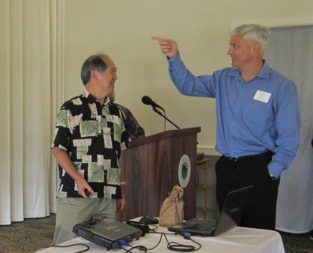 HAPI Executive Director Jon Young and Robert Kroning, the Director of the City and County of Honolulu, Department of Design and Construction have a final check before Kroning's presentation at the general meeting January 2015. Young states they are one of the industry's largest clients, bidding out about $130 million per year.
