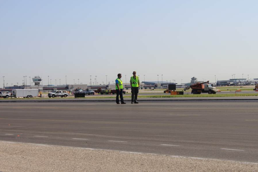 PAIKY Executive Director Brian Wood checks out the asphalt work at the airport.