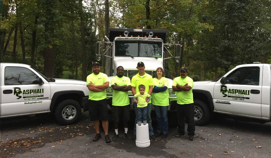The RS Asphalt Maintenance team. Back row, from left to right: Tommy Bell, Tim Hayward, Casey Greinermiller (President), Gail Frey (Office Manager), Ruben Salazar. Front row, center: Dean Greinermiller. Not pictured: Dennis Brenizer