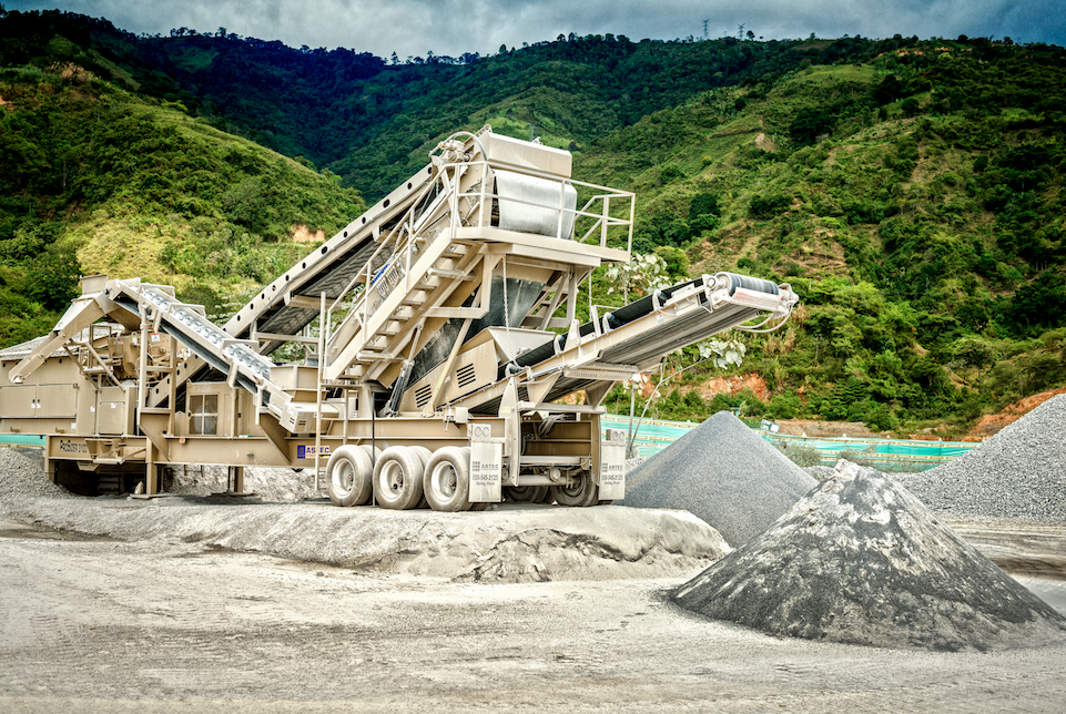 """To make the most of crushing tonnage, the crew classified the raw aggregates and removed the fines on the screens prior to crushing. """"This feature has greatly helped us be more effective and arrive at a much more real crushing tonnage, thus preventing the fines from wearing out parts or components of the machines used.""""—Mario Huertas"""