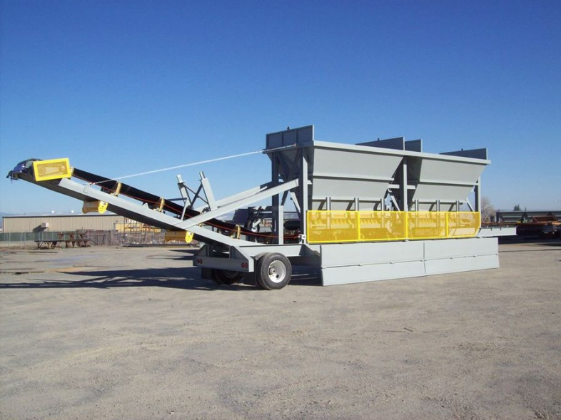 Rock Systems rolled out a new feeder system about a year ago called the portable 2 bin RAP feeder. It's designed to introduce fractionated RAP to the asphalt plant and can be built portable or stationary. Despite its name, it can come with two or three bin configurations.