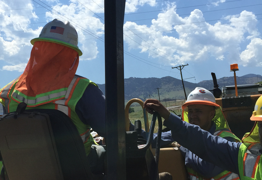 Hardhat brims, like you see here, are very popular with the crew at Martin Marietta Denver Metro Paving Division. Not only does it keep you cooler, but it also prevents sunburn. Photo courtesy of Ray Eisner.