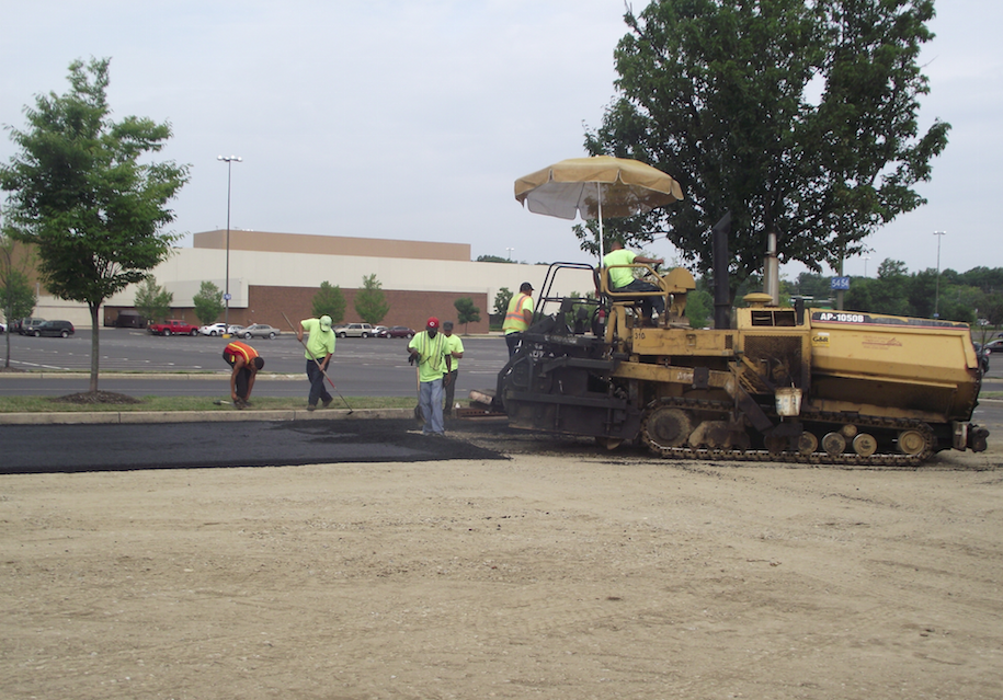 Shade is the third tenet of OSHA's mantra: water, rest and shade Most equipment manufacturers are providing shade for operators, like you see here. Photo courtesy of American Asphalt Company.