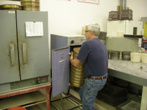 Lab Tech Steve Russell prepares sieves for testing at one of The Shelly Company/Oldcastle Materials labs.