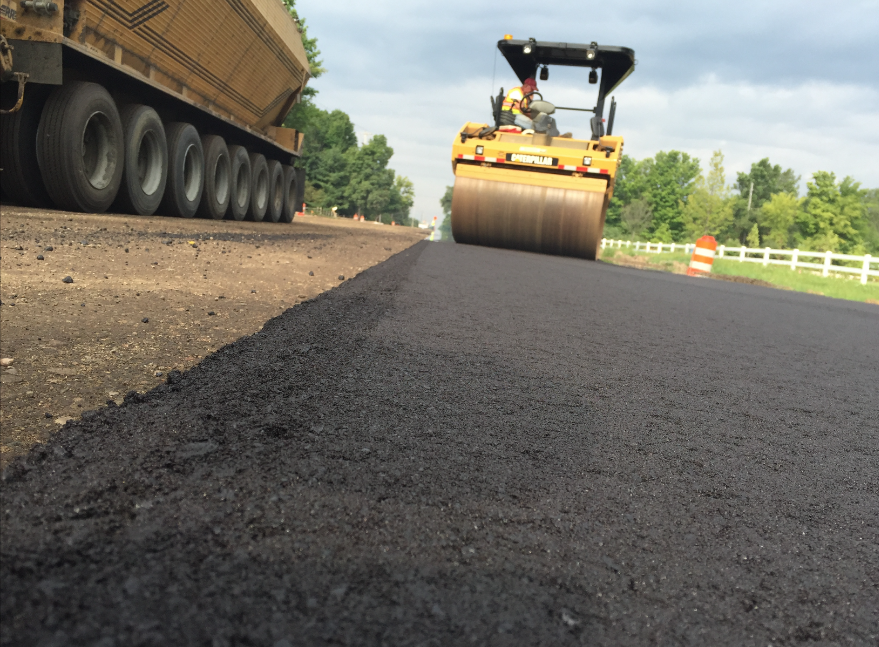 If you notice a tender zone coming up with the treated crumb rubber mix, make sure you get the breakdown roller on the mat directly behind the screed to get density quickly. Photos courtesy Liberty Tire Recycling.