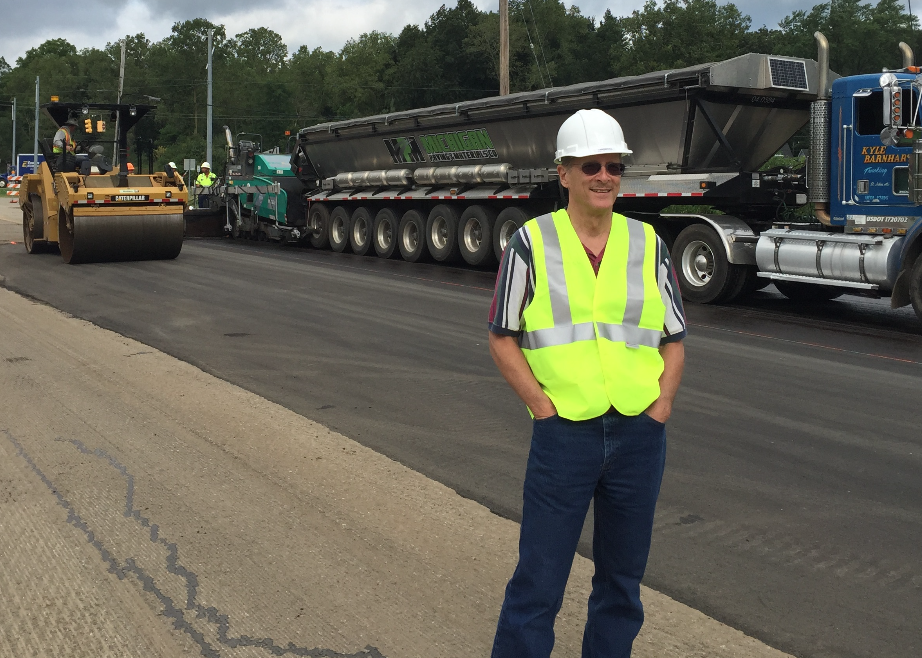 Peter Blyth, president of Innovative Polymer Solutions, monitored placement of the his innovation—Mix Maxer—during the placement of rubberized asphalt on Lake Lansing Road in East Lansing, Michigan in August 2015. Photo courtesy Liberty Tire Recycling.