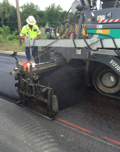 """Dan Troia of Ingham County recalled a discussion with the paving crew that, """"our standard specification 5E1 top course control mix was very tender, and they had difficulty getting density, but the crumb rubber modified 5E1 top course mix was less tender than the control mix, and getting density was actually less problematic than for the control."""" Photo courtesy Liberty Tire Recycling."""