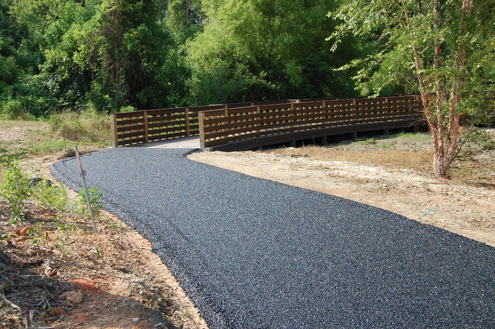 The overall project in the natural resource area included repair of the two-acre pond's dam and installation of the porous asphalt walking path and two boardwalks.