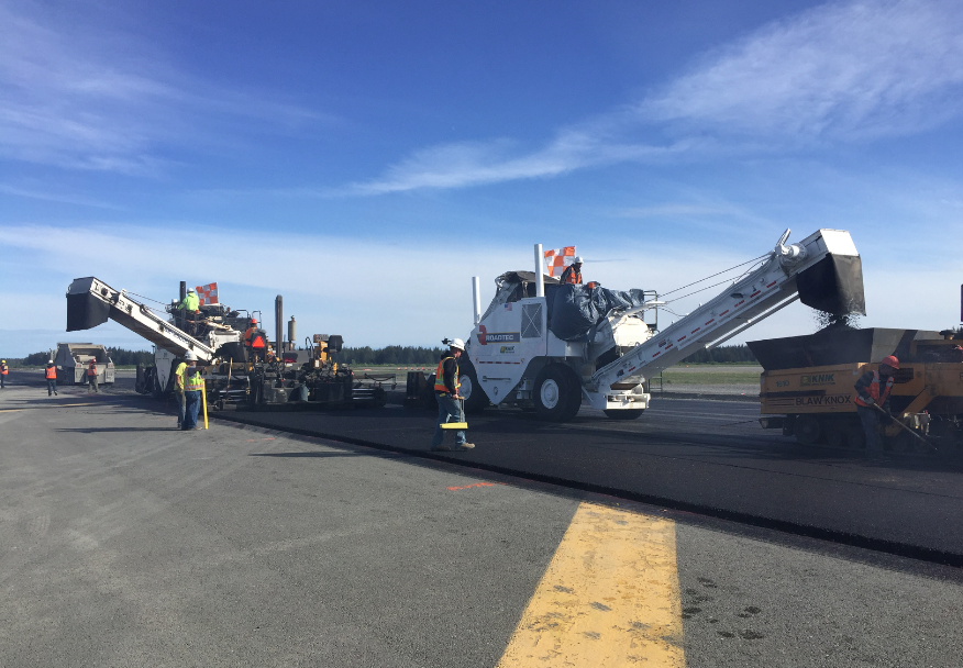 On a good production day, Knik Construction paved as much as 6,000 tons, leaving the top lift of the runway with very few transverse joints. Notice that by paving in echelon, the team created a hot joint that did not require any additional heating to get a good, smooth blend.