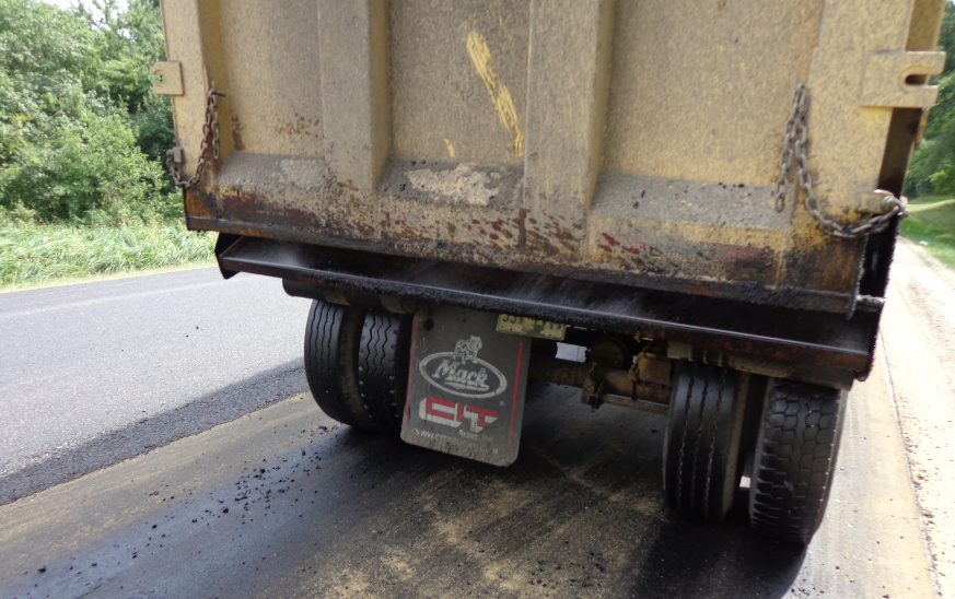 Haul trucks leaving the paver dribble very little—if any—mix because none is stuck to the treated tailgates.