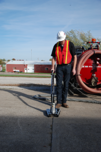 Pictured on a Ring-O-Matic 550, the crack cleaner adds utility to the vacuum-excavator.