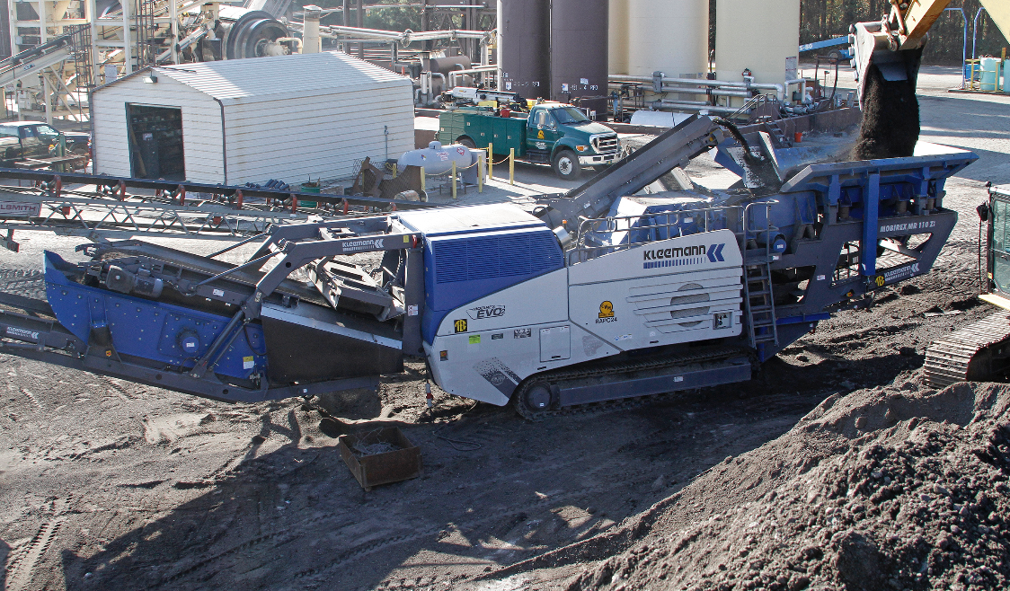 """The two Mobirex impact crushers are moved around among 26 asphalt plants throughout the company. """"The hopper wings fold hydraulically, there are no tools involved,"""" Greg Taylor said. """"The only thing we really must do is take the side discharge belt from the prescreen off."""""""