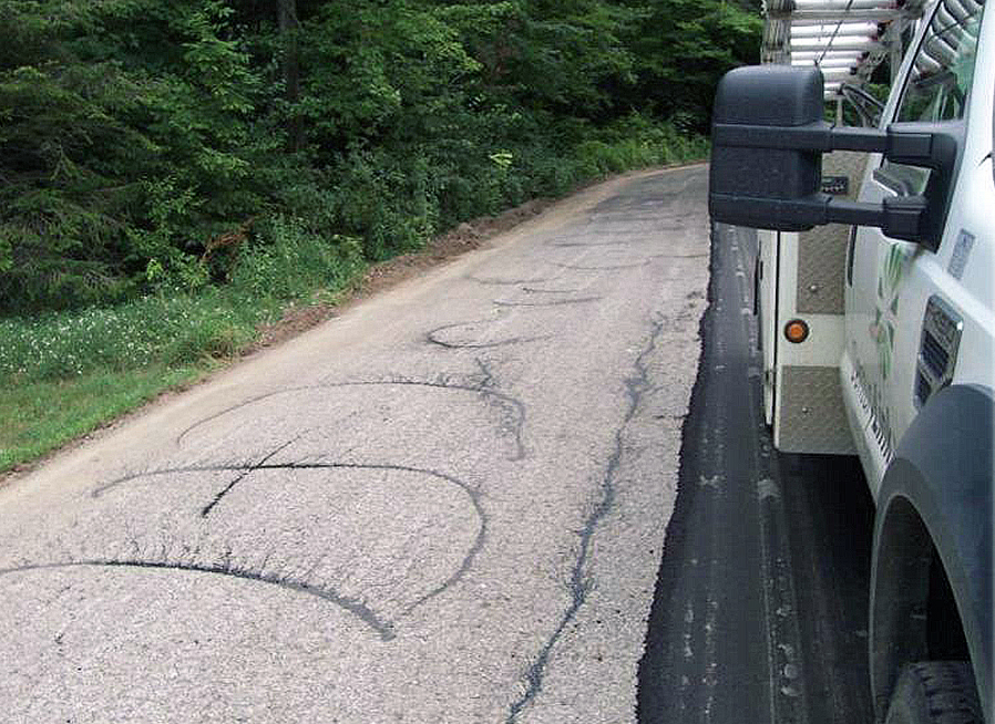 So-called 'zebra' tack pattern will achieve less than 50 percent available adhesion, leading to potential overlay failure. Photos courtesy Asphalt Institute.