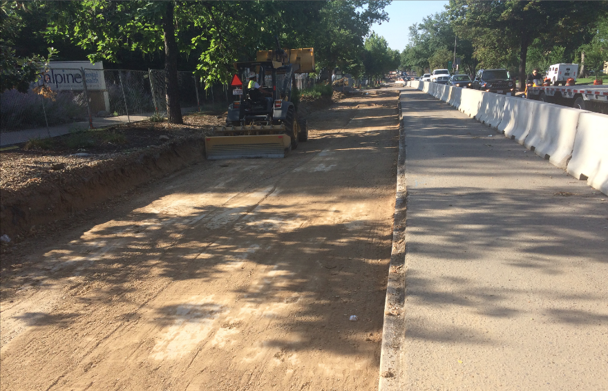Prior to placing the base course in the FDR section, the crew had to grade the area, as you see here. You can also see the 6-foot steel fence the crew had to use to better control the heavily trafficked pedestrian areas.