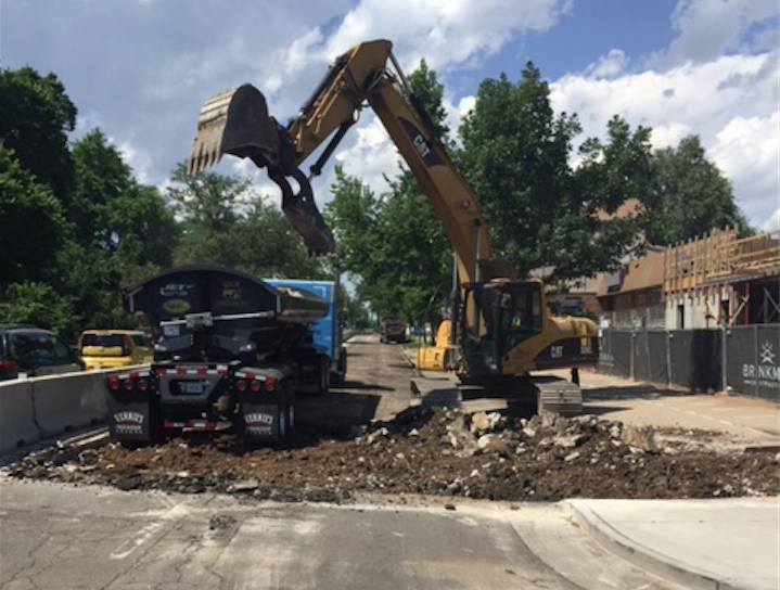 The crew had to remove 3-to-5 inches of asphalt overlay, as well as 6-inch-thick concrete panels underneath, as you see here.