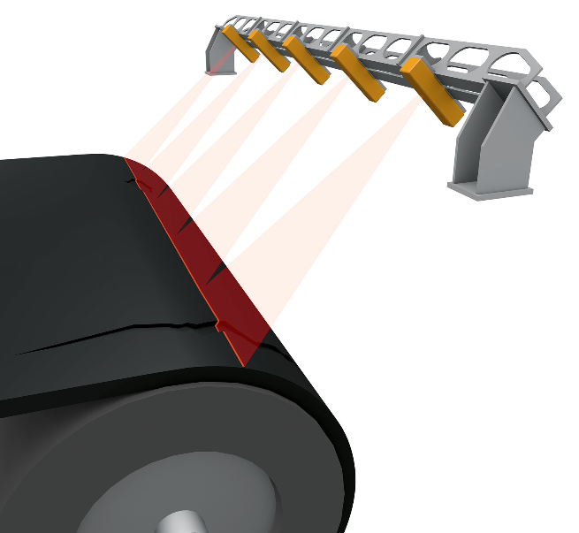 The ContiAlert conveyor belt monitoring process from Continental exposes a red bonding layer below the top cover when it's time to change the belt, and before the carcass is exposed.
