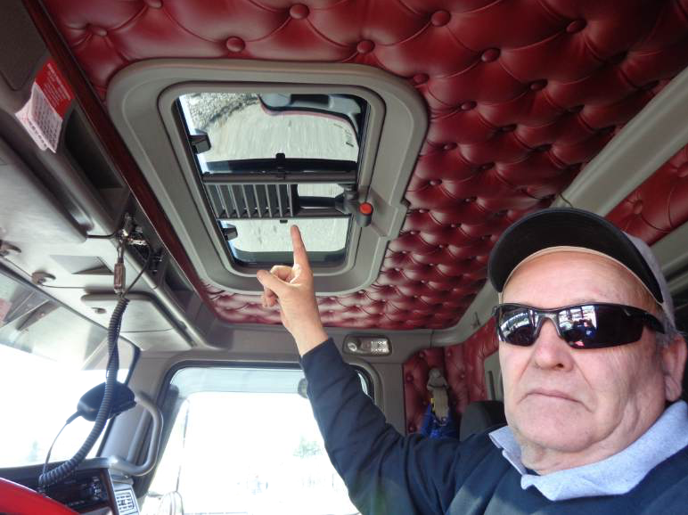 Here Steve Murray of Steve Murray Trucking, Hooksett, New Hampshire, points to the sunroof he had installed for safety on his truck. All photos courtesy John Ball, Top Quality Paving & Training, Manchester, New Hampshire.