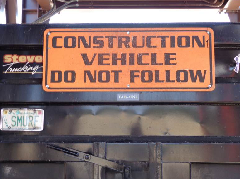 "All trucks must have a clean and visible ""Construction Vehicle—Do Not Follow"" sign. It's the law. Part of your daily, pre-shift walk-around should include looking at this sign to ensure it is clean, legible and in good repair. Photo courtesy John Ball of Top Quality Paving & Training, Manchester, New Hampshire."