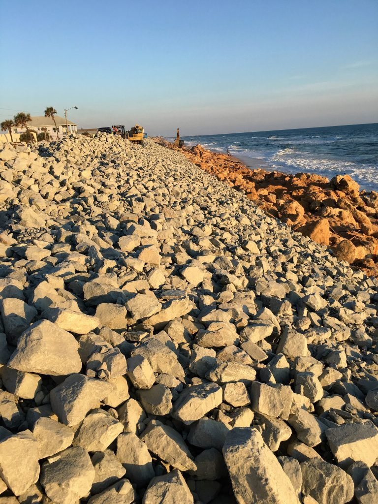 During: Halifax Paving rebuilt the shoreline as well, using imported sand, granite and boulders.