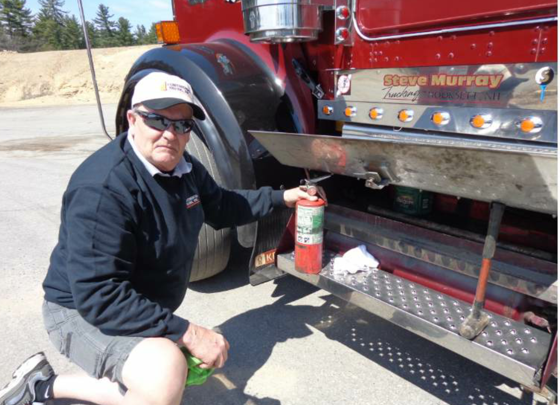 Every truck driver should have the basics for safety. Make sure you double-check the expiration date on your fire extinguisher as part of your weekly routine maintenance. One of these days, you'll need to replace it. Also notice the coffee can Murray keeps under his step. That's not coffee. He keeps an assortment of nuts, bolts and screws in the can. The pipe you see under there is used at the back of the truck for leverage to open the chute to facilitate handwork.