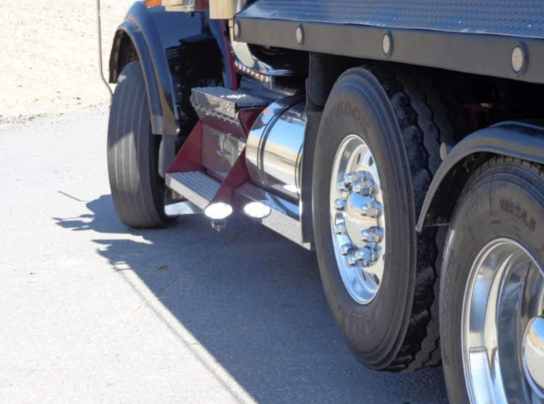The placement of this oval-shaped LED allows it to shine toward the paver, illuminating the wheels and the area where the paver's push roller will come in contact with the back tire. The driver wants to see that there is nothing between his vehicle and the paver as he's backing.