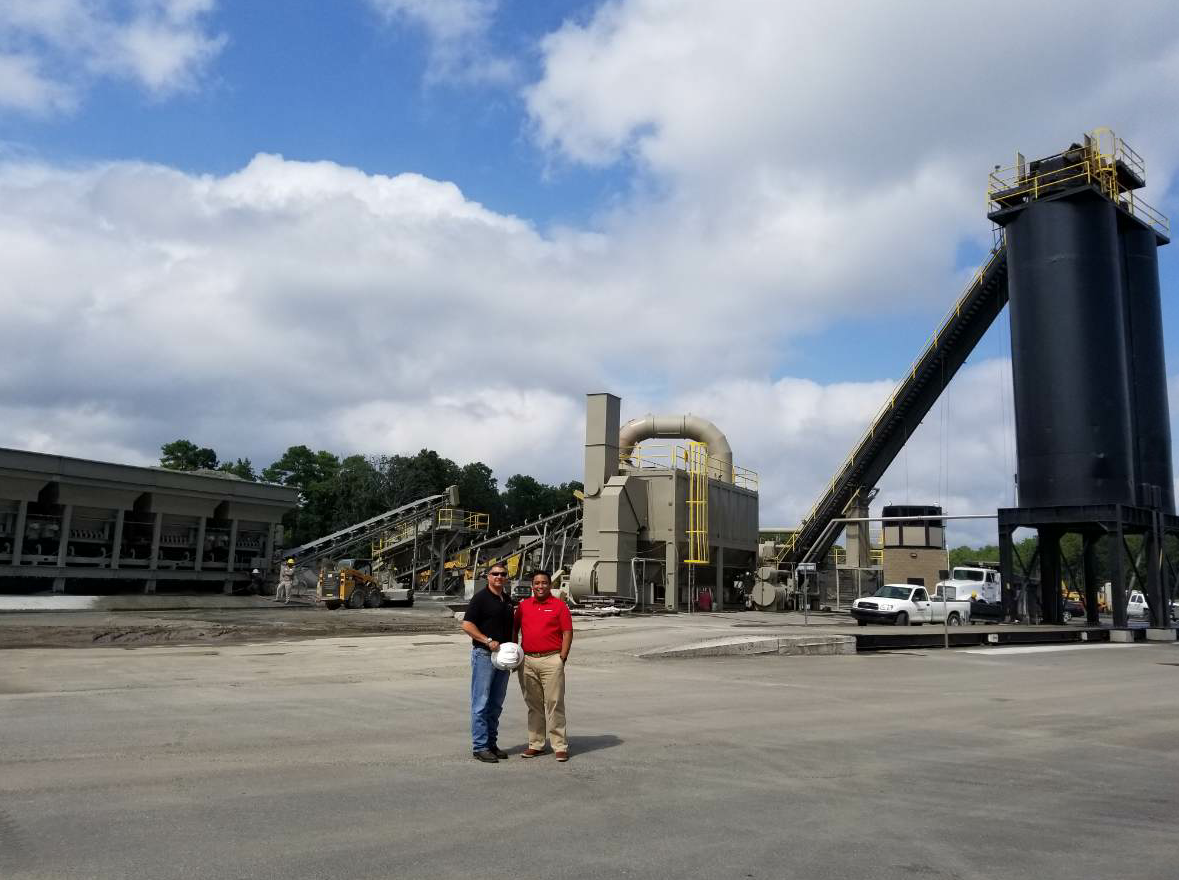 Tim Kopec (at left) and Manny Tejano (at right) visit the ALmix drum plant at the Butner facility.