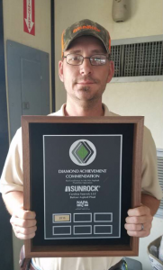 Michael Heitzman shows the most recent NAPA Diamond Achievement Commendation for the Carolina Sunrock family.