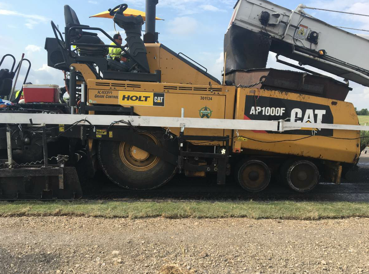 Austin Materials uses a spray paving system from Integral dx on a Cat AP1055F paver, which can be removed within a day.