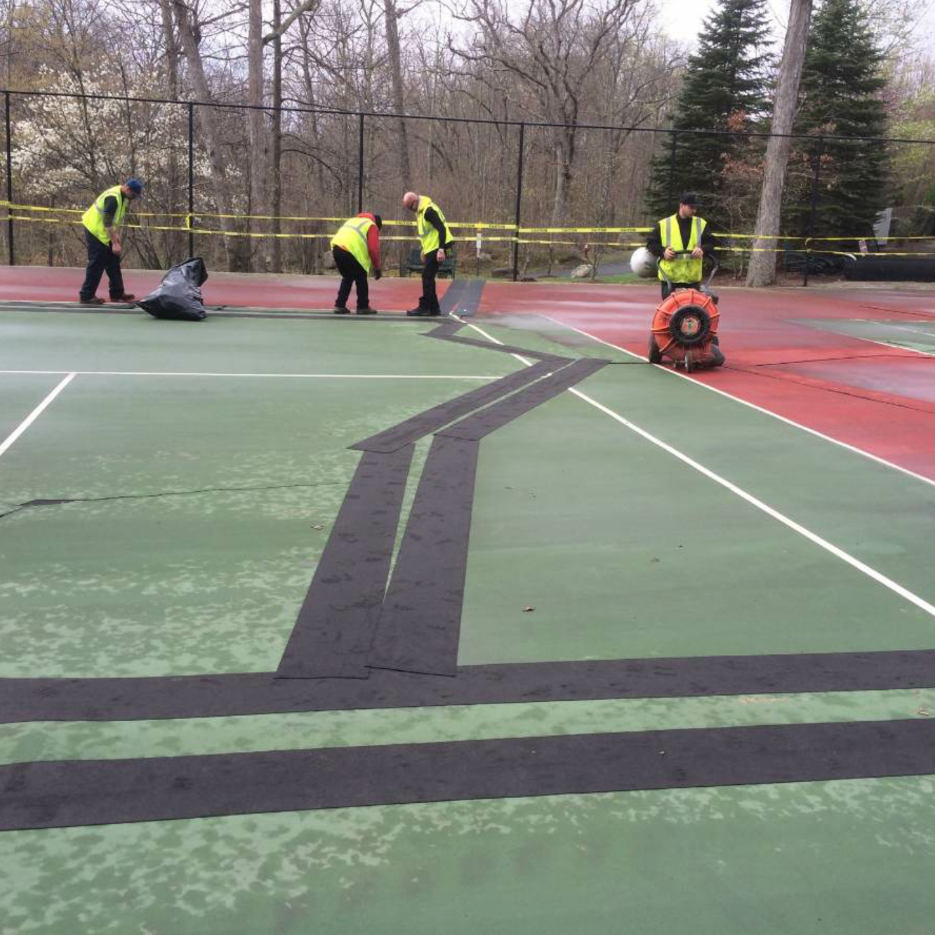 The project in Tuxedo included repairs, application of a membrane over all structural cracks, a leveling course and a new surface overlay, as well as color and striping.