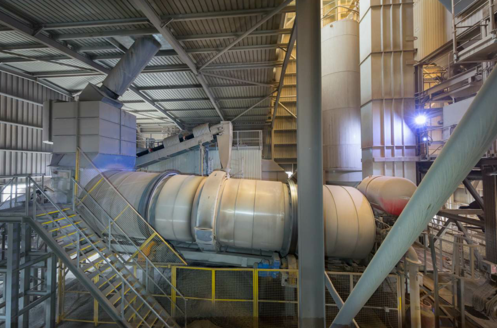 Aggregate Industries is committed to sustainable practices. They have an enclosed facility and covered bins to keep dust down, and they've incorporated RAP mixes at their Ammann ABP 240 Universal Asphalt-Mixing Plant.