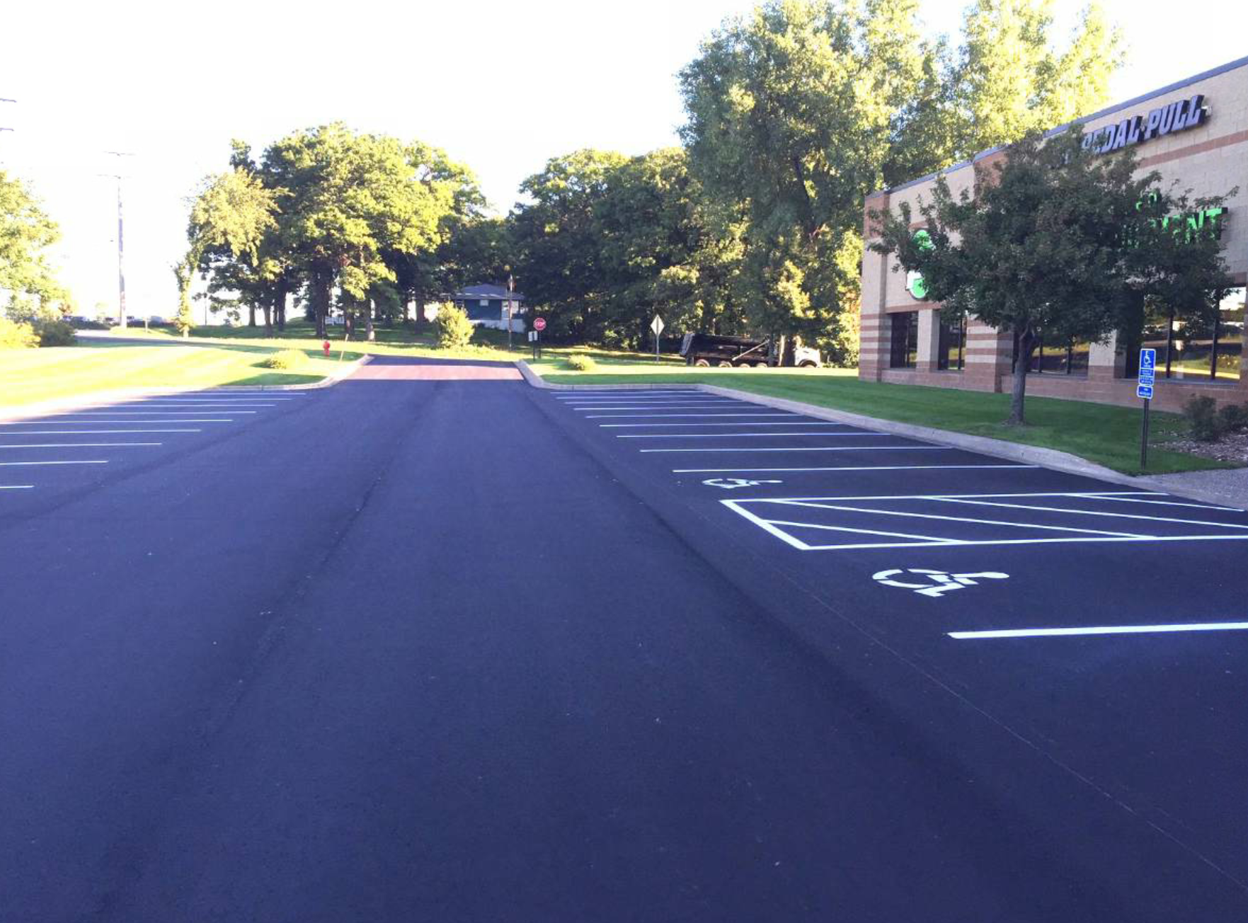 Some parking lots are good candidates for a simple sealcoat and restripe to freshen their appearance and seal out water.