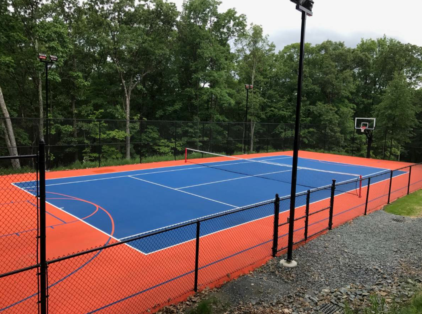 At a private residence in Chester, New York, Superior's crew did a complete reconstruction of a multi-sportcourt. The project included site work, drainage, subbase, binder and surface course and a personsonalized color system for the homeowner.