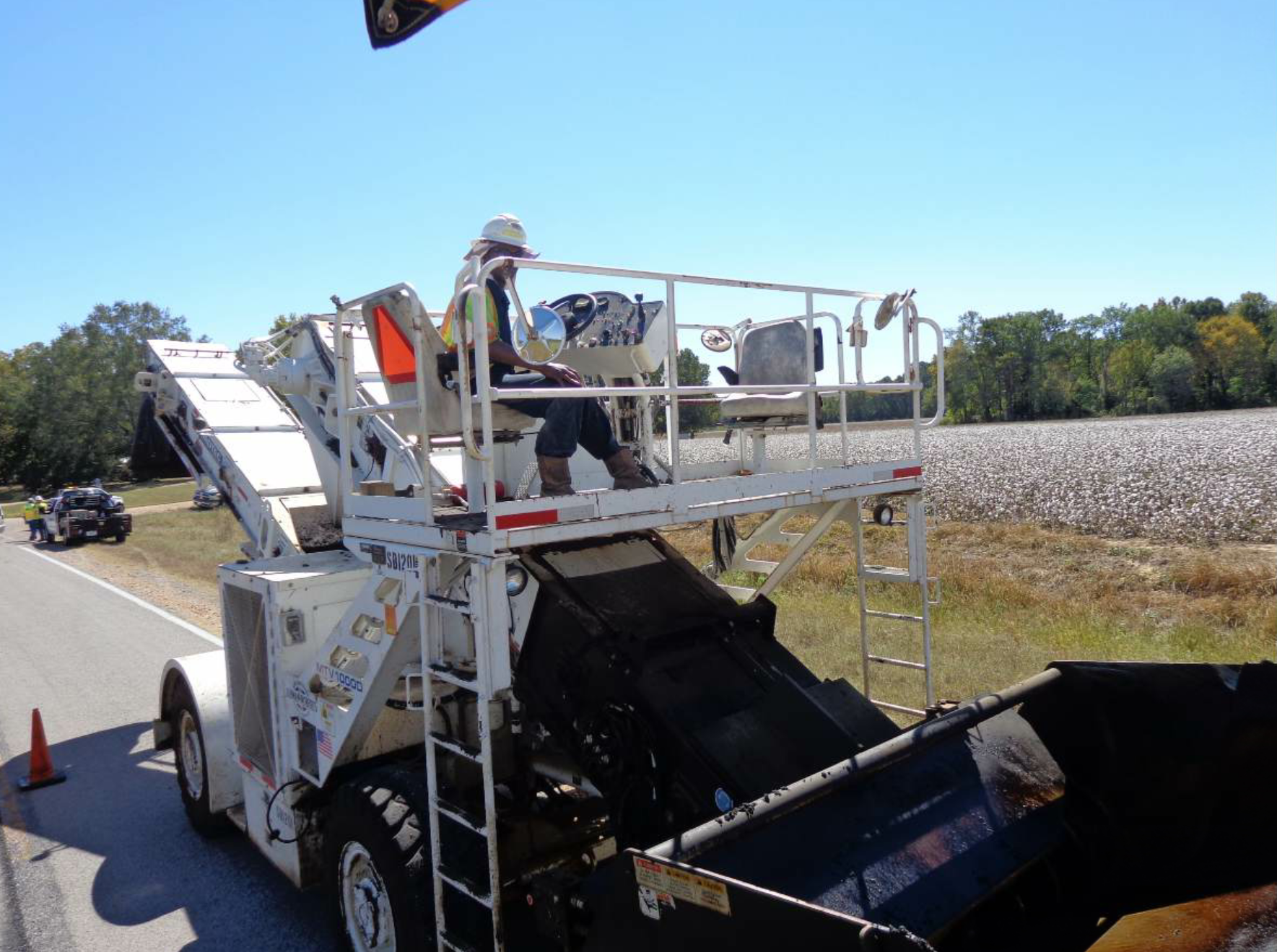 This material transfer vehicle operator has several convex mirrors positioned around his platform so he can see objects or persons in the blind spots around the machine.