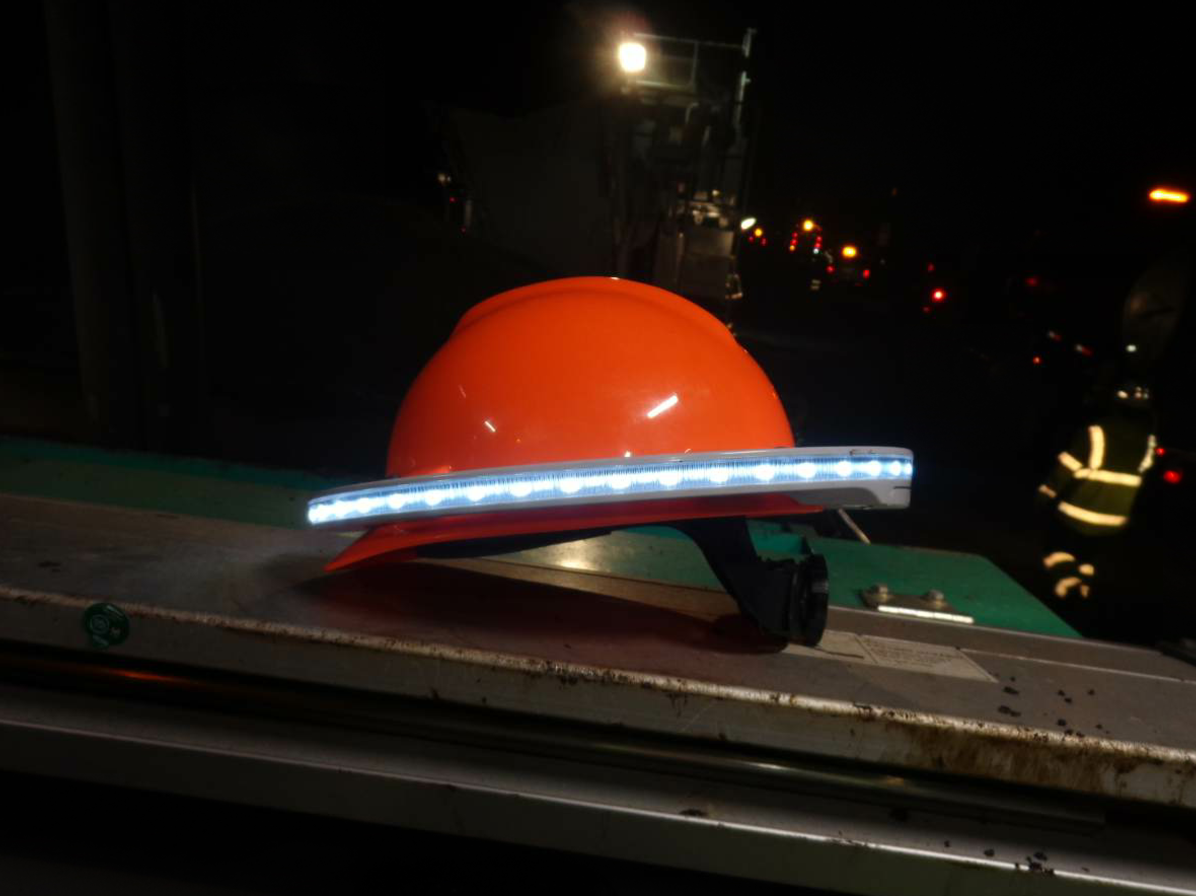 As we've reported in the magazine before, the Halo Light attaches to a standard hard hat, creating an extra ring of visibility for the worker.