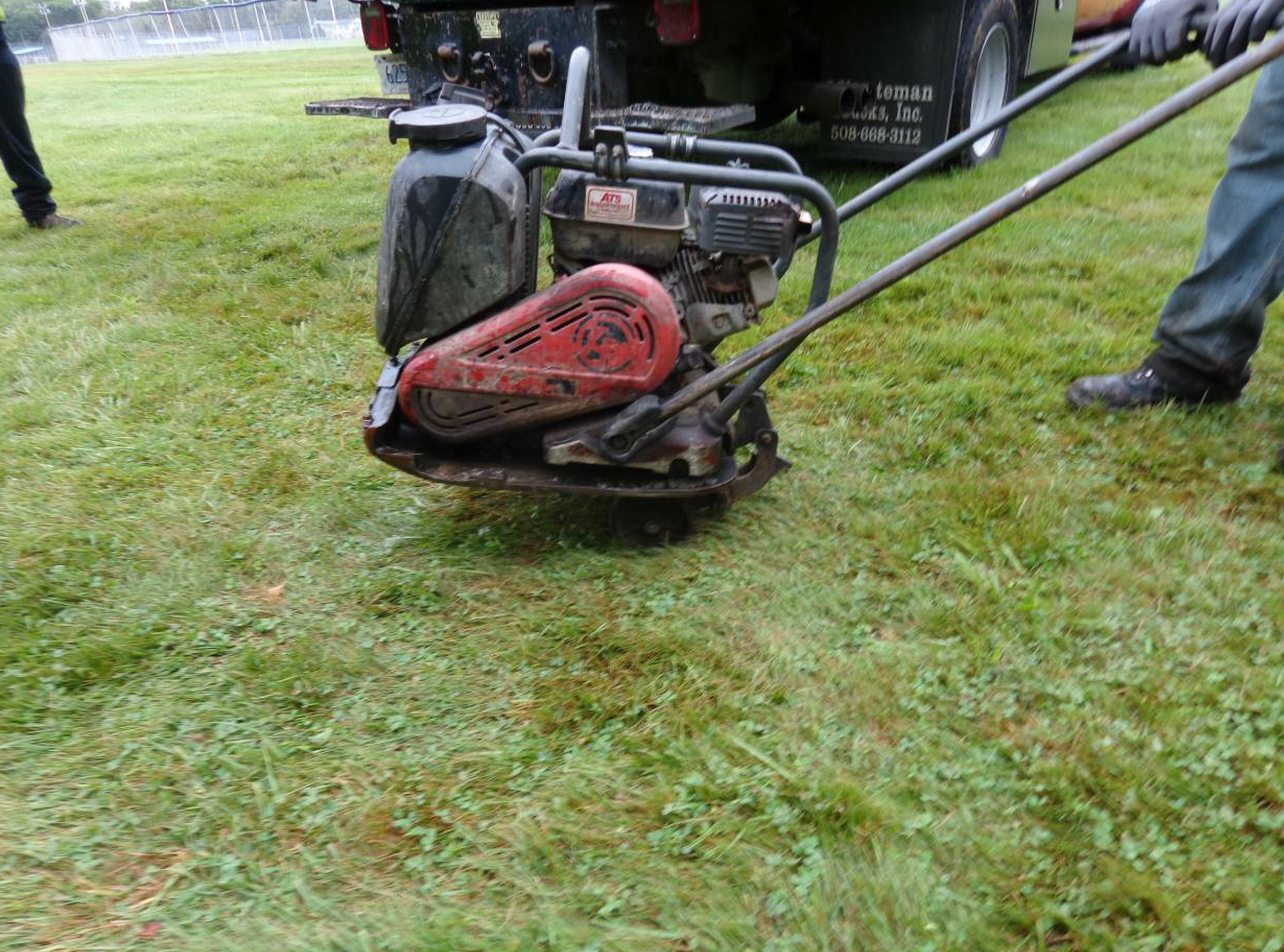 When the laborer is finished compacting an area, he can lower the wheels using the hinge to swing them down, under the plate. This makes rolling the plate compactor to another area of the work zone much easier.