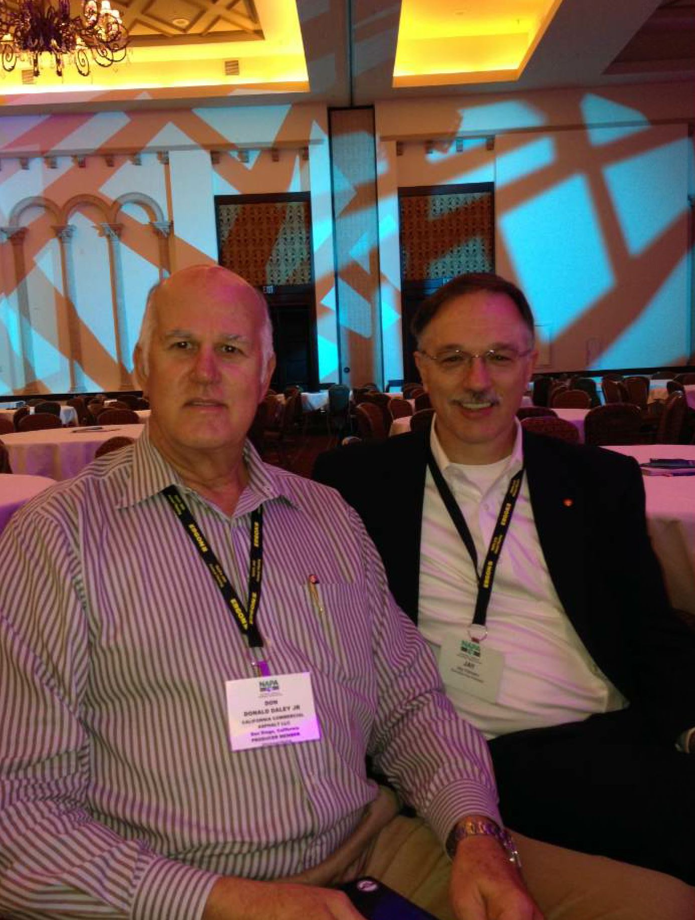 Don Daley Jr., (left) was recognized with NAPA's Asphalt Ambassador Commendation in 2014. Here, he sits next to NAPA Executive Vice President Jay Hansen at NAPA's Annual Meeting. Photo by the California Asphalt Pavement Association (CalAPA) – used with permission.