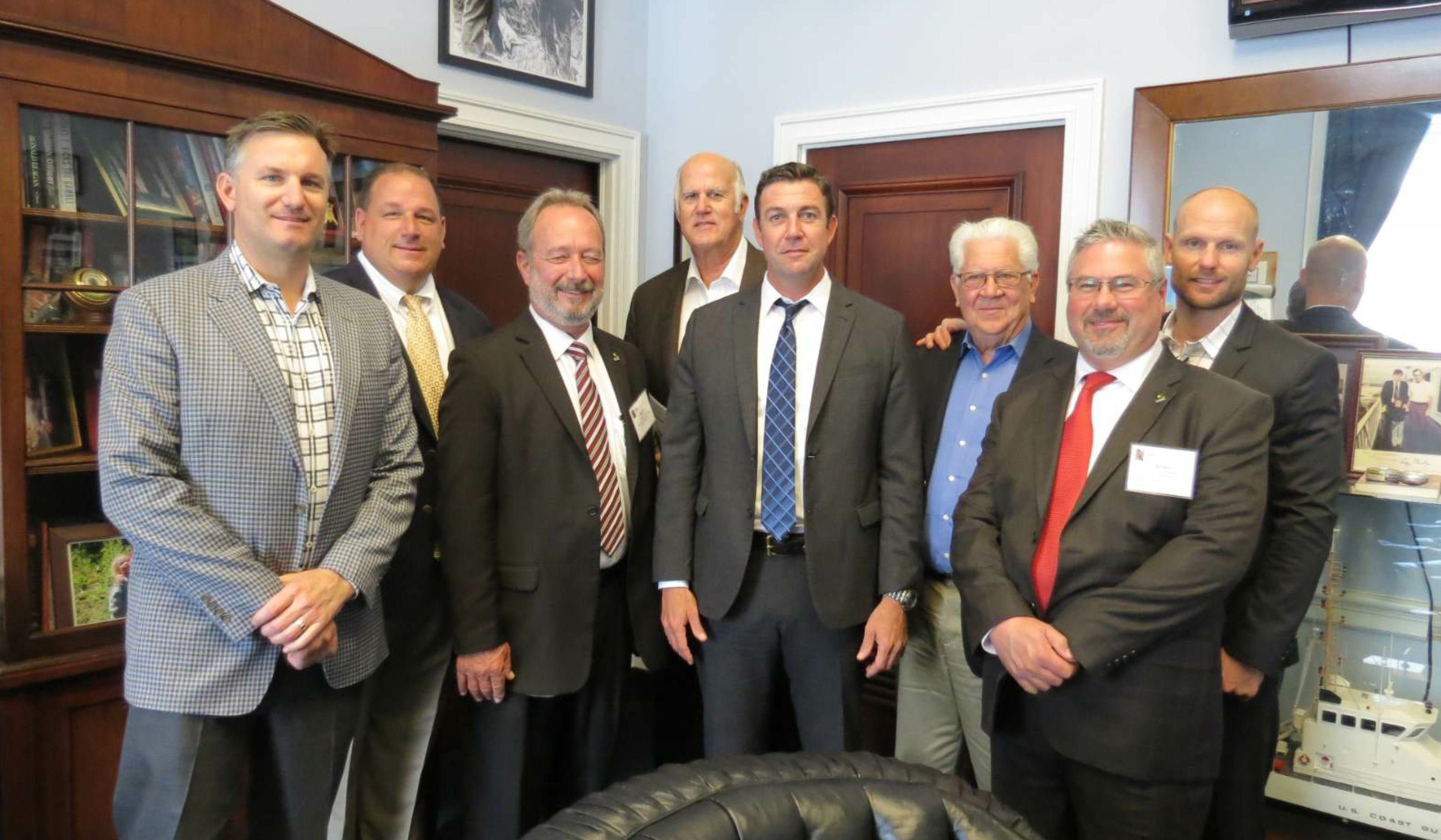 """The CalAPA delegation poses with U.S. Rep. Duncan Hunter (CA-50) during the Transportation Construction Coalition """"fly-in"""" held March 17 and 18, 2017, in Washington, D.C. Pictured, from left to right, are Don L. Daley III, ATP General Engineering (CalAPA Legislative Committee Chair); Scott Metcalf, Ergon; Steve Ward, Pavement Recycling Systems; Don L. Daley Jr., California Commercial Asphalt; Hunter; Len Nawrocki, Valero (CalAPA 2017 PAC Committee Chair); Brian Handshoe, Kenco Engineering Inc. (2018 CalAPA PAC Committee Chair); and John Greenwood, California Commercial Asphalt (CalAPA Immediate Past Chairman). Photo by the California Asphalt Pavement Association (CalAPA) – used with permission."""