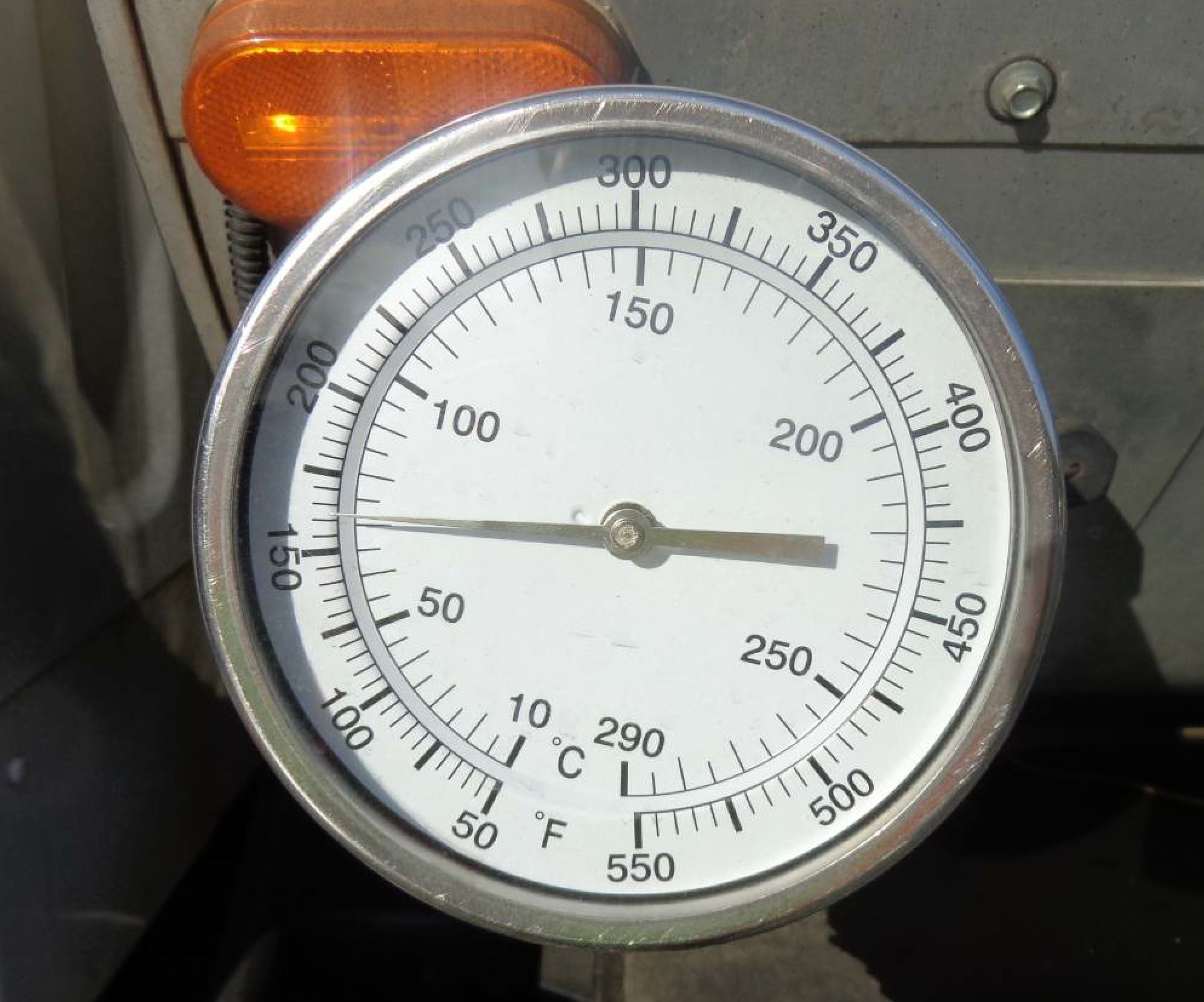 Don't guess at what the temperature might be. Know it. Even the temperature of each individual tire on the pneumatic roller gives you clues to its pressure. The gauge in this photo tells you the temperature of the material in the tack wagon. Each step of the paving process has a temperature you'll want to know. Photo courtesy John Ball of Top Quality Paving.