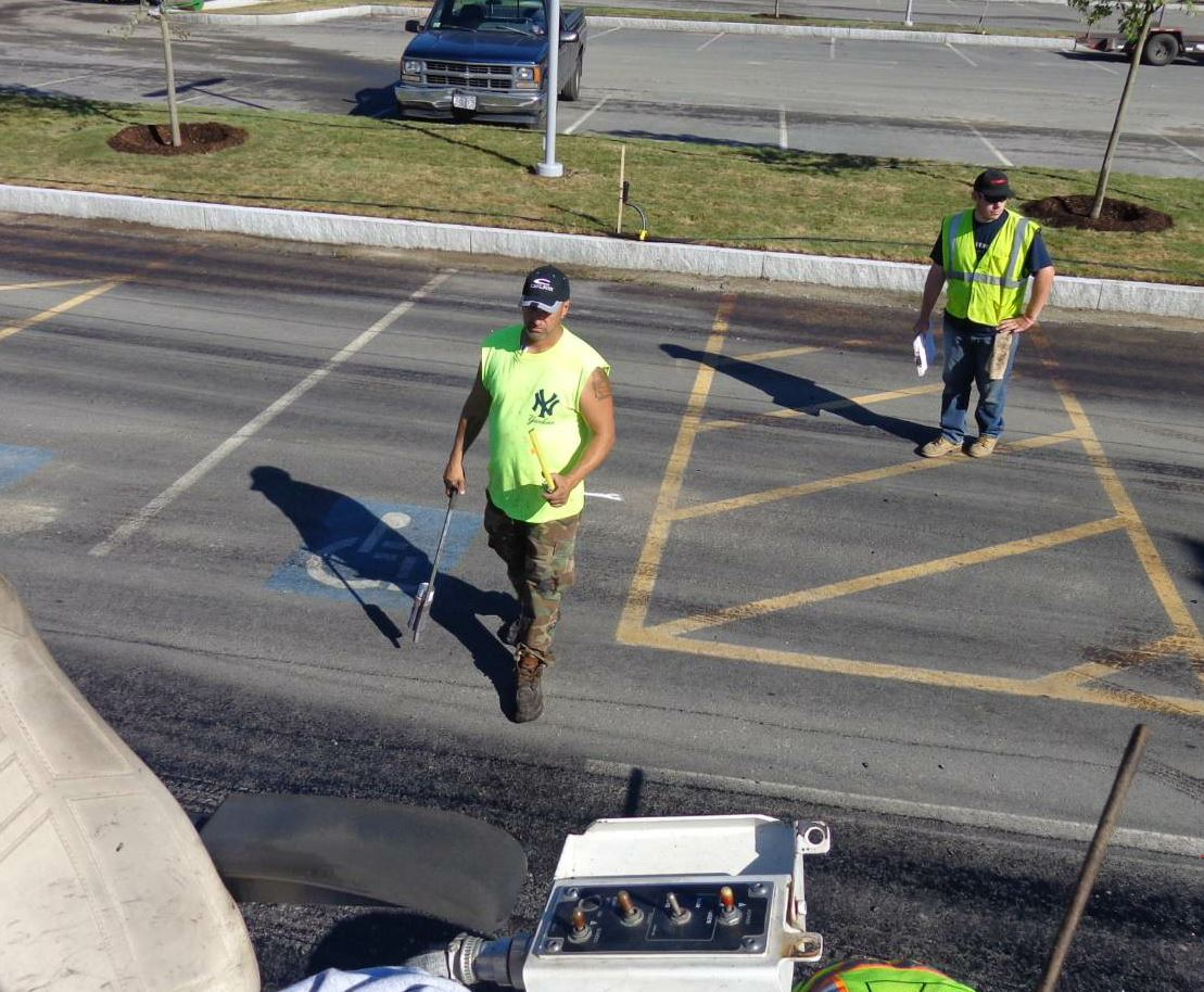 The foreman will either line out the job himself or work with the laborers to line it out, measuring and marking the lanes to be paved so the project finishes in its most timely fashion with no wasted material.
