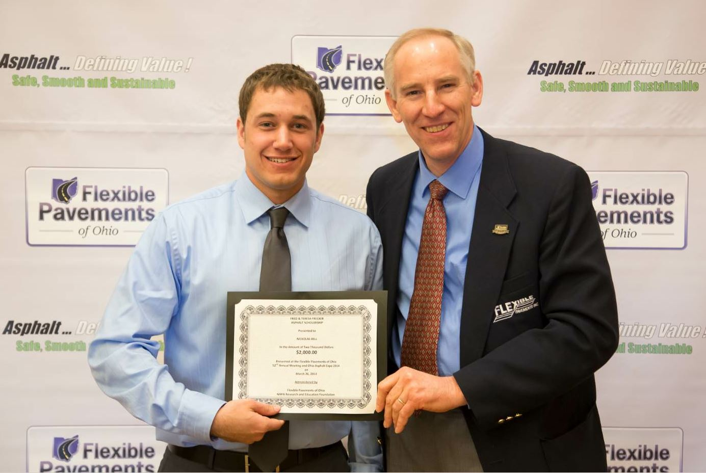 FPO's asphalt scholarship program began in 1996. To date, the program has awarded 448 scholarships for a total value of $598,000. Here, Ursich (right) awards a recent scholarship recipient.