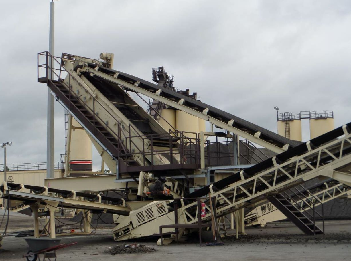 Chris McGuire is the regular wheel loader operator who feeds the reclaimed asphalt pavement (RAP) into the fractionating plant from KPI-JCI. The plant has two RAP bins calibrated for coarse RAP and fine RAP.