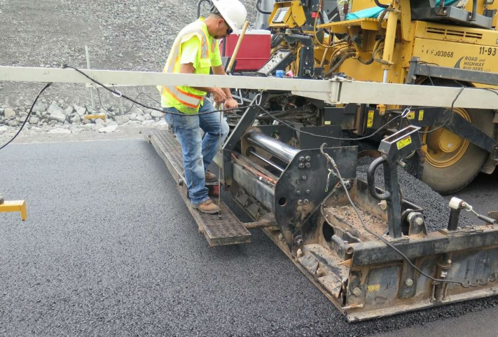 The east side alignment consisted of a 5-inch asphalt pavement, including a 3-inch lift of Marshall mix and a 2-inch top lift of Superpave.
