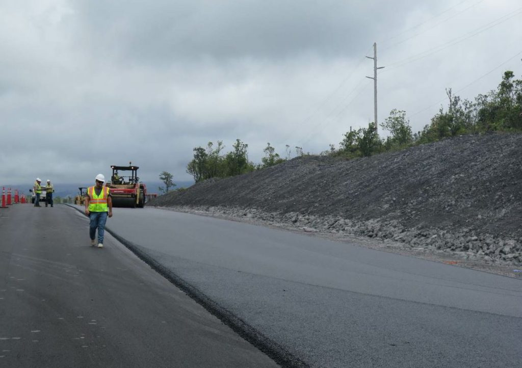 "In total, the job required 36,000 tons of Marshall mix and 24,000 tons of Superpave. The crew paved the steep project downhill to minimize the chances of equipment getting stuck. This also let them pave ""away"" from the plant so loaded trucks didn't have to turn around on the subgrade or base course."