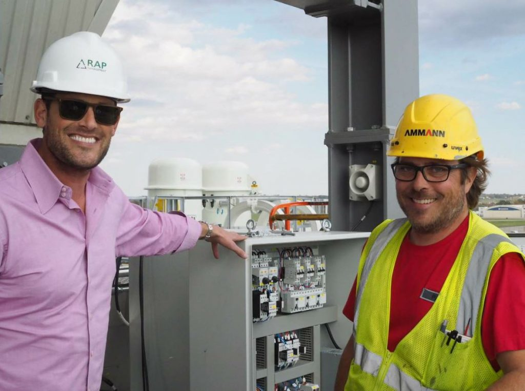Ryan Smith and Ammann's Patrick Hutter put some finishing touches on the new plant.