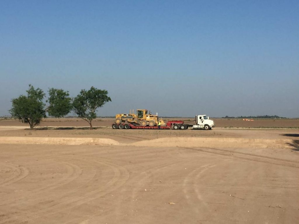 Texas Cordia's Lowboy drops off the company's Blade to prepare for the new hot mix plant.