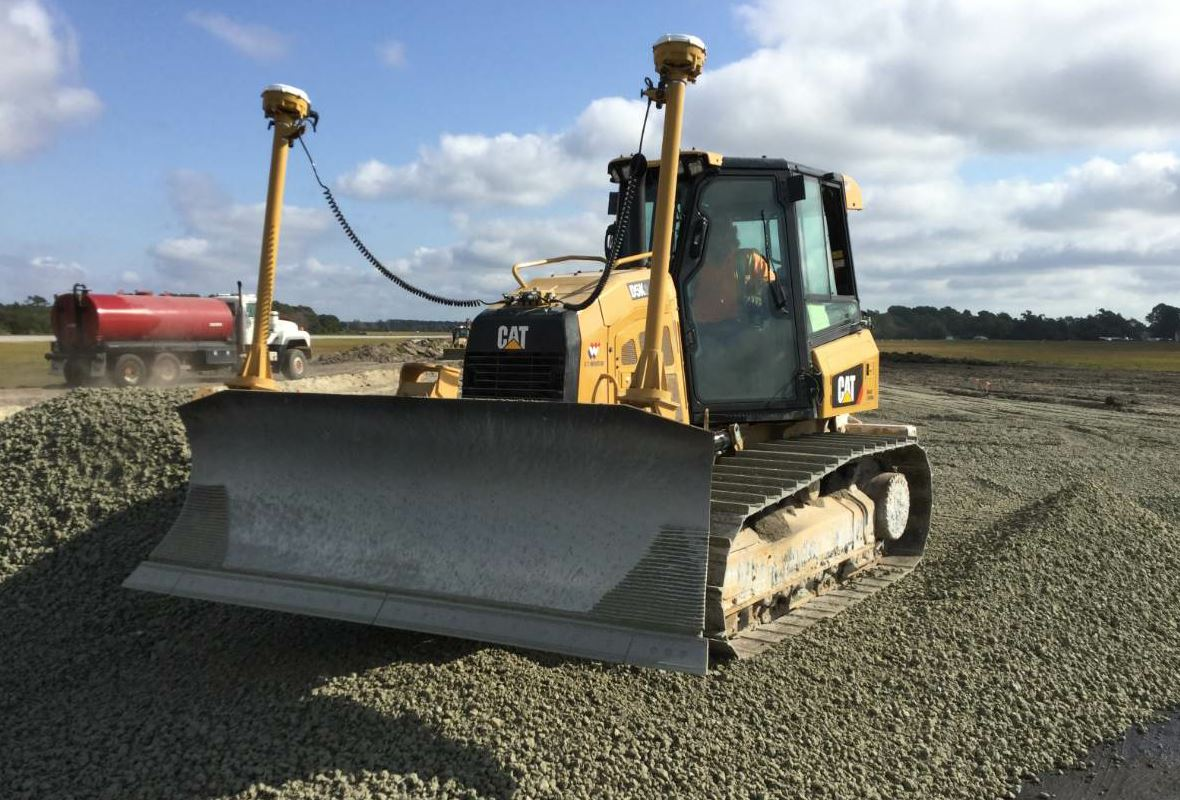 The crew placed 8 inches of P-209 crushed aggregate base course on the taxiway. A GPS grade control system also served as a tool for precision fine grading during the stone-base portion of the project.