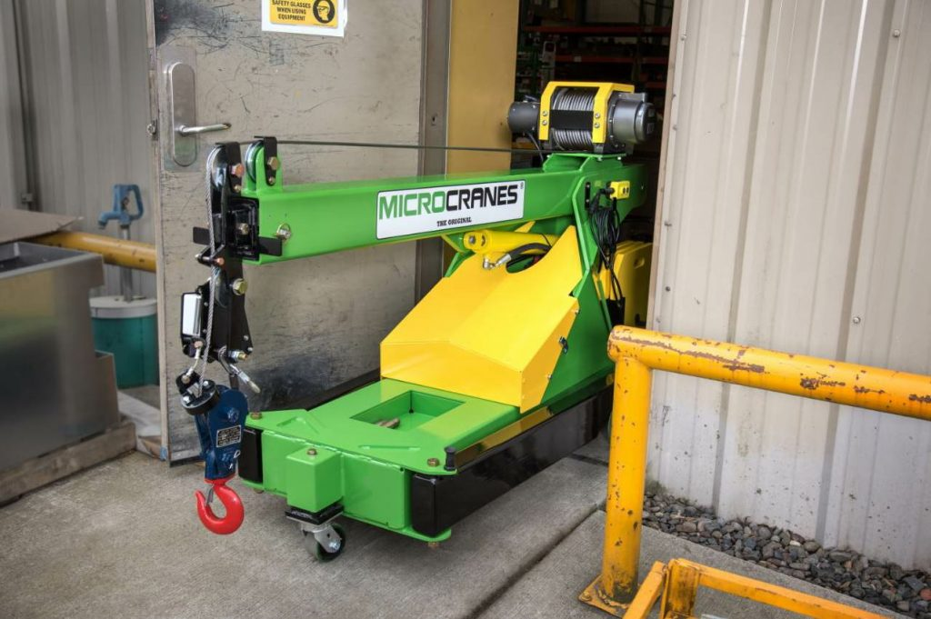 The M1 Global microcrane is 30 inches wide for transporting, then unfolds from the sides and back for stabilization.