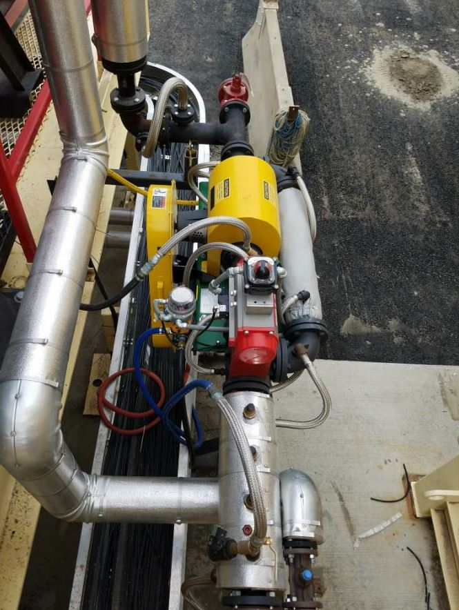 The Accu-Shear® from Stansteel/Hotmix Parts is installed in the asphalt injection line prior to the plant mixing zone.