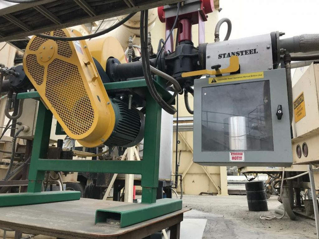 Personnel can get samples of the foamed (or blended) product via the Safe-T-Station™ immediately after the Accu-Shear Advanced for continuous drum plant liquid blending unit. Photo courtesy Stansteel.