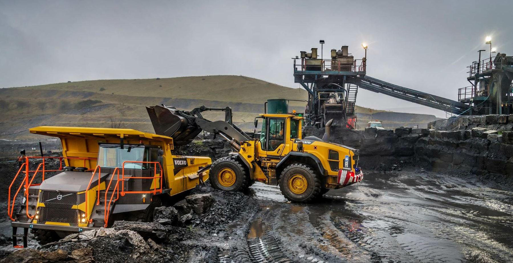 "Processing the larger boulders close to the face will allow ""fuller"" loads with fewer voids, thus a more efficient operation. Photo courtesy Volvo Construction Equipment."